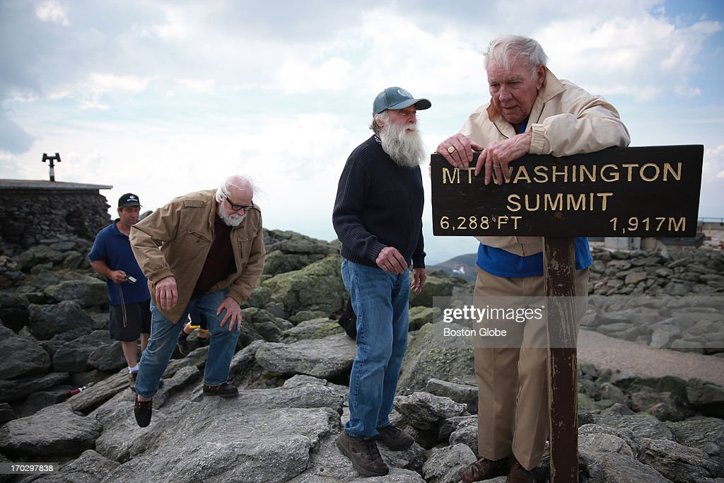 Guy Gosselin, left, makes his way to the summit of Mount Washington to reunite with Gerry Wright, middle, and Harold Addison, right. Gosselin, who was working at the observatory atop the mountain helped Wright and Addison, who needed food and shelter from the cold and high winds during their summit attempt 50 years ago. Gosselin also drew them a map on the safest route down. They have reunited 50 years later on top of Mount Washington.