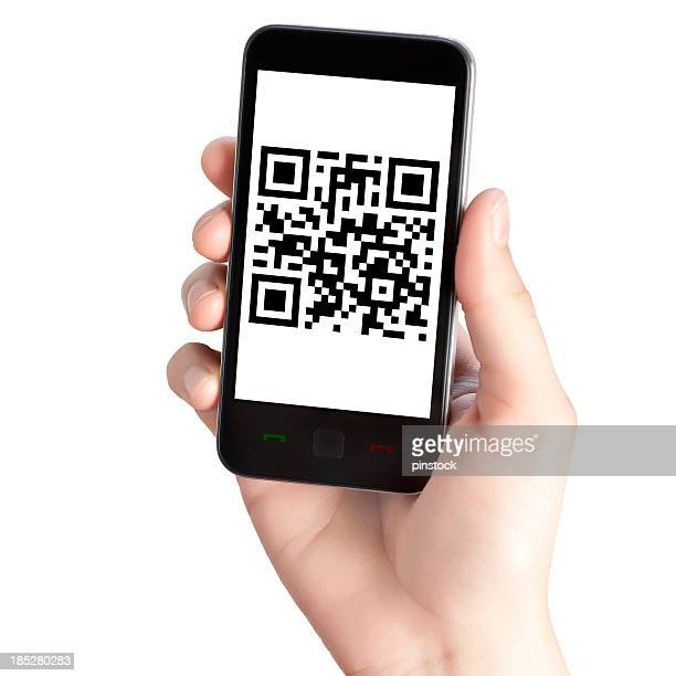 A guy holding a phone with the screen showing the QR code