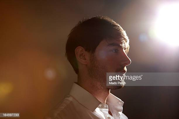 Guy in venue with flare of light behind him