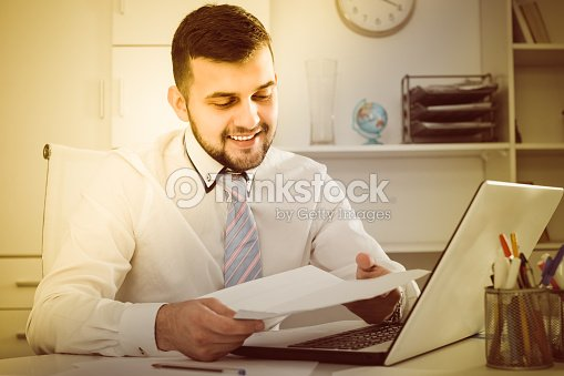 guy is signing agreement papers stock photo thinkstock