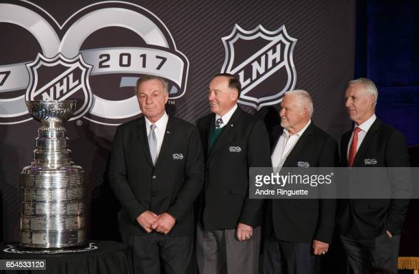Guy Lafleur Frank Mahovlich Bernie Parent and Mike Bossy stand with the Stanley Cup as they are introduced during the 2017 Scotiabank NHL 100 Classic...