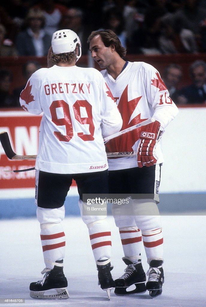 <a gi-track='captionPersonalityLinkClicked' href=/galleries/search?phrase=Guy+Lafleur&family=editorial&specificpeople=210706 ng-click='$event.stopPropagation()'>Guy Lafleur</a> #10 of Canada talks with <a gi-track='captionPersonalityLinkClicked' href=/galleries/search?phrase=Wayne+Gretzky+-+Ice+Hockey+Player&family=editorial&specificpeople=157520 ng-click='$event.stopPropagation()'>Wayne Gretzky</a> #99 during the 1981 Canada Cup Final against the Soviet Union on September 13, 1981 at the Montreal Forum in Montreal, Quebec, Canada.
