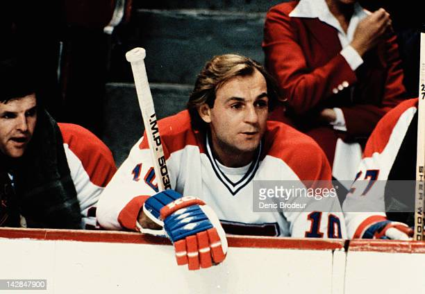 Guy Lafleur of the Montreal Canadiens follows the action from the bench Circa 1976 at the Montreal Forum in Montreal Quebec Canada