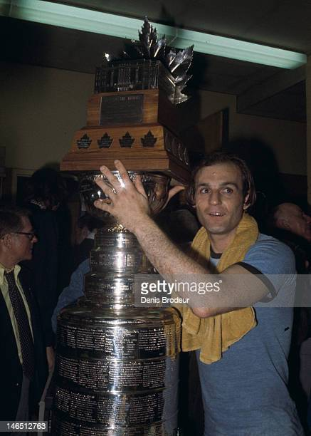 Guy Lafleur of the Montreal Canadiens poses for a photo with the Stanley Cup Trophy and the Conn Smythe Trophy after defeating the Philadelphia...