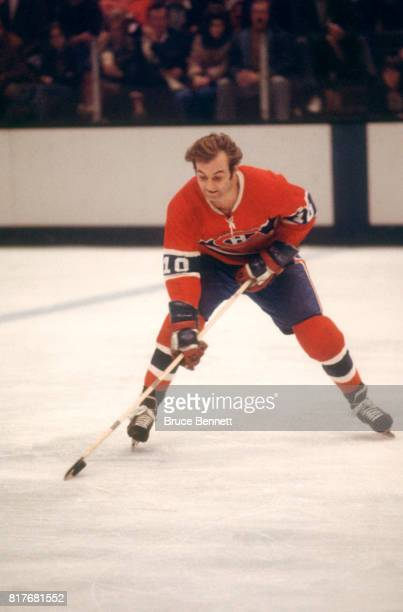 Guy Lafleur of the Montreal Canadiens skates on the ice with the puck during an NHL game against the California Golden Seals circa 1976 at the...
