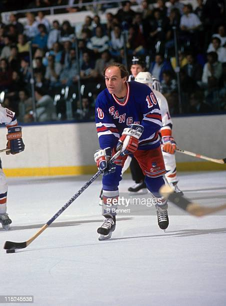 Guy Lafleur of the New York Rangers skates with the puck during an NHL game against the New York Islanders circa 1988 at the Nassau Coliseum in...