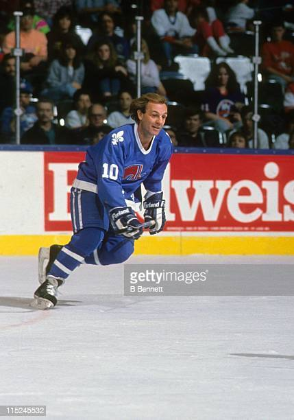 Guy Lafleur of the Quebec Nordiques skates on the ice during an NHL game against the New York Islanders circa 1990 at the Nassau Coliseum in...