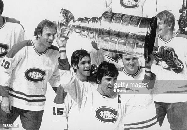 Guy Lafleur Rejean Houle Serge Savard Rick Chartraw and Pierre Mondou of the Montreal Canadiens celebrate as they follow team captain Serge Savard...