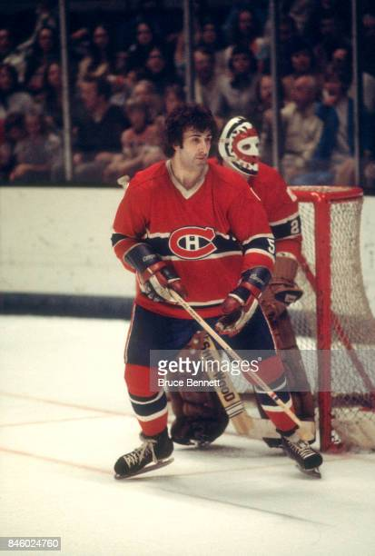 Guy Lapointe and goalie Ken Dryden of the Montreal Canadiens defend the net during an NHL game against the California Golden Seals circa 1976 at the...