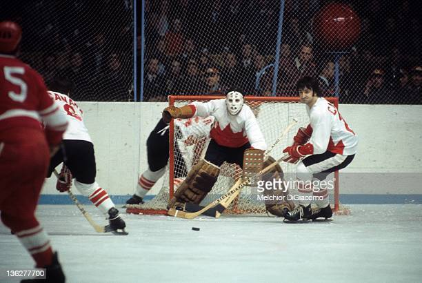 Guy Lapointe of Canada looks to play the puck as goalie Tony Esposito defends the net during their game against the Soviet Union in the 1972 Summit...