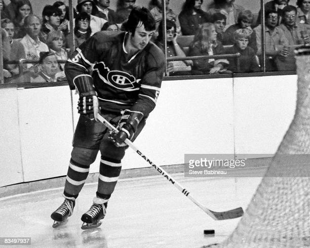 Guy Lapointe of the Montreal Canadiens carries puck in game against the Boston Bruins at Boston Garden