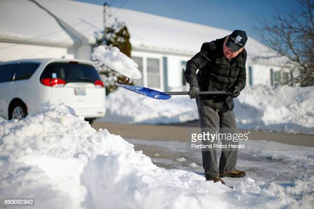 Guy Linscott a longtime resident of South Portland tidies up his driveway after it was cleared by a plow truck Lindscott lives next to the Portland...