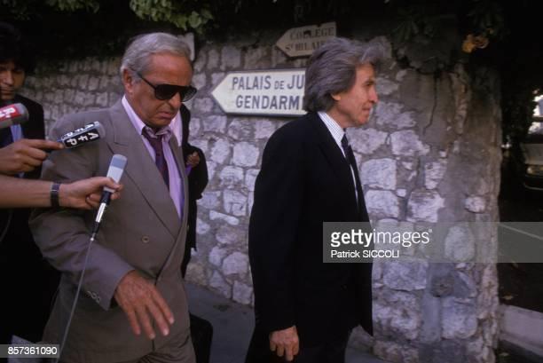 Guy Lux arrive au tribunal avec l'avocat Paul Lombard le 5 septembre 1988 a Grasse France