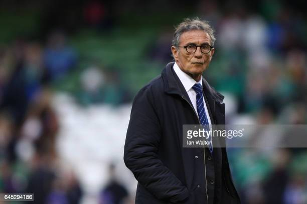 Guy Noves the head coach of France watches over his team's warm up prior to kickoff during the RBS Six Nations match between Ireland and France at...