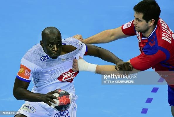 Guy Oliver Nyokas of France is pushed by Bojan Beljanski of Serbia during the Men's 2016 EHF European Handball Championships match between Serbia and...