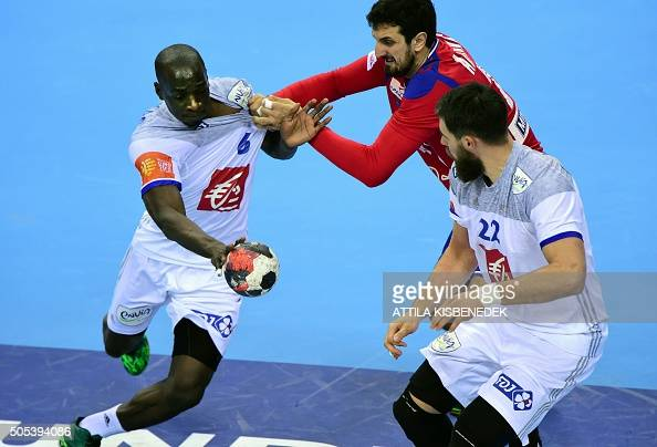 Guy Oliver Nyokas of France is pushed by Ilija Abutovi of Serbia during the Men's 2016 EHF European Handball Championships match between Serbia and...