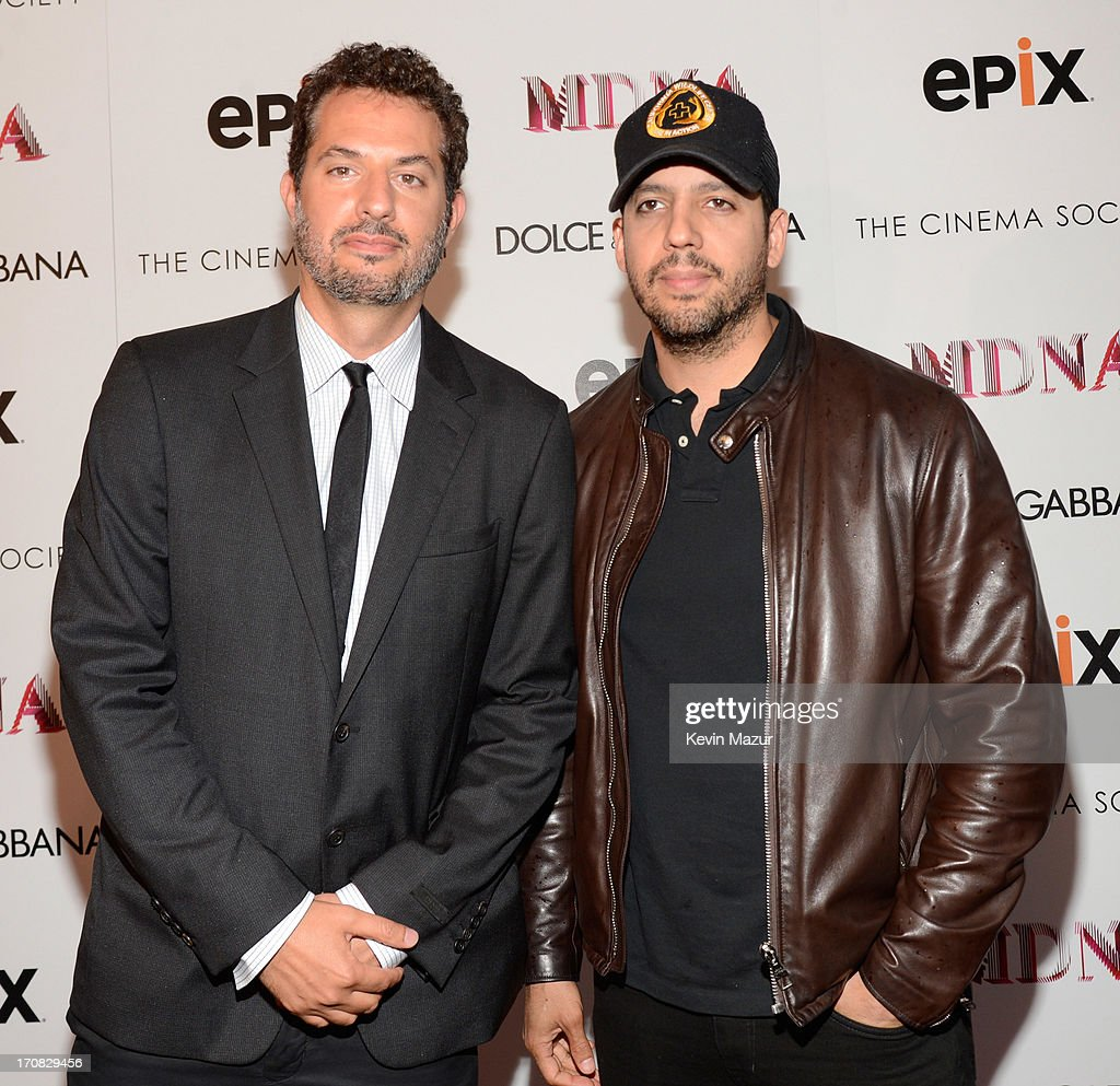 <a gi-track='captionPersonalityLinkClicked' href=/galleries/search?phrase=Guy+Oseary&family=editorial&specificpeople=243241 ng-click='$event.stopPropagation()'>Guy Oseary</a> and <a gi-track='captionPersonalityLinkClicked' href=/galleries/search?phrase=David+Blaine&family=editorial&specificpeople=165238 ng-click='$event.stopPropagation()'>David Blaine</a> attend the Dolce & Gabbana and The Cinema Society screening of the Epix World premiere of 'Madonna: The MDNA Tour' at The Paris Theatre on June 18, 2013 in New York City.