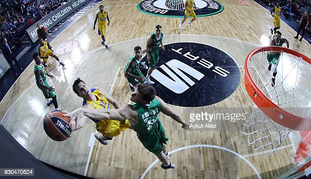 Guy Pnini #10 of Maccabi Fox Tel Aviv competes with Luke Harangody #81 of Darussafaka Dogus Istanbul during the 2016/2017 Turkish Airlines EuroLeague...