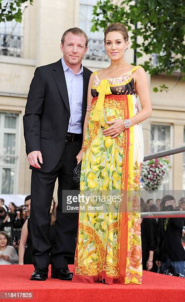Guy Ritchie and Jacqui Ainsley arrive at the World Premiere of 'Harry Potter And The Deathly Hallows Part 2' in Trafalgar Square on July 7 2011 in...