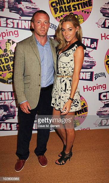 Guy Ritchie and Jacqui Ainsley attend a benefit evening for The Hoping Foundation on July 10 2010 in London England