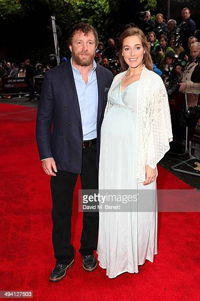 Guy Ritchie and Jacqui Ainsley ttends the UK Premiere of 'Edge Of Tomorrow' at the BFI IMAX on May 28 2014 in London United Kingdom