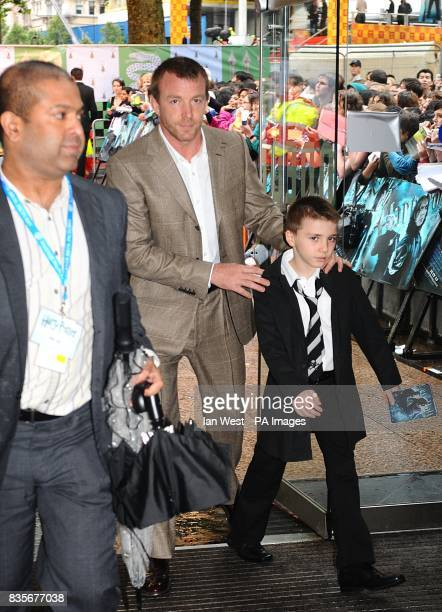 Guy Ritchie and son Rocco arriving for the world premiere of Harry Potter and the HalfBlood Prince at the Odeon Leicester Square London