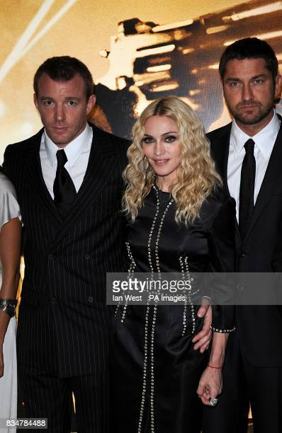 Guy Ritchie Madonna and Gerard Butler arrive for the UK Film Premiere of RocknRolla at the Odeon West End Cinema Leicester Square London
