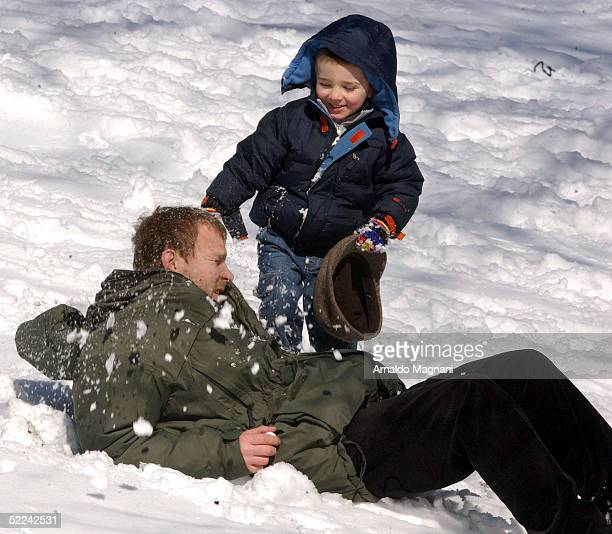 Guy Ritchie plays with his son Rocco in Central Park February 25 2005 in New York City