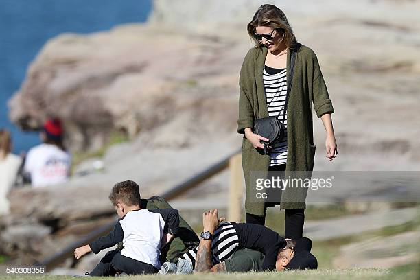Guy Sebastian and his wife Jules enjoy a morning walk along the coast with their children Hudson and Archer on June 10 2016 in Sydney Australia