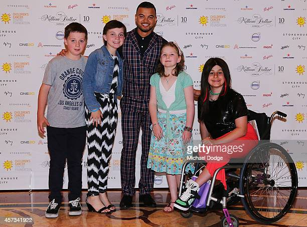 Guy Sebastian poses with kids that are in remission from cancer at the 10th anniversary celebration of The Million Dollar Lunch at the Park Hyatt on...