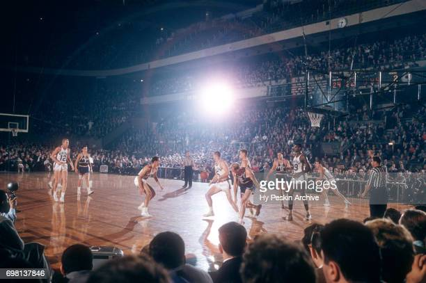 Guy Sparrow of the New York Knicks goes for the loose ball during an NBA game against the Philadelphia Warriors on November 3 1957 at Madison Square...