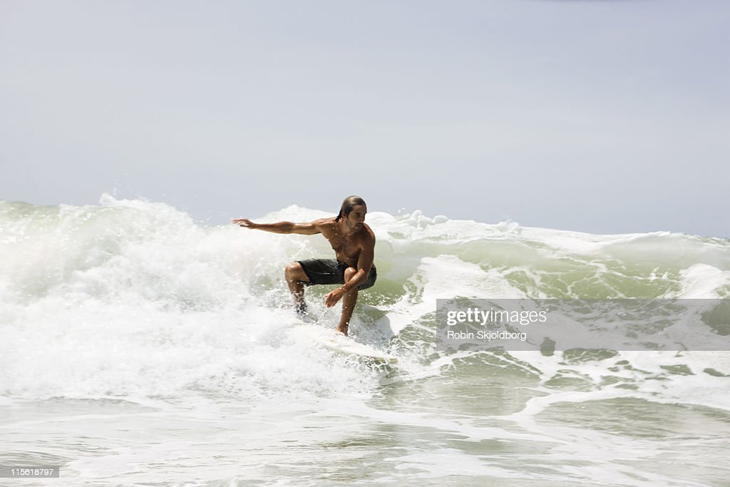 Guy surfing on wave : Stock Photo