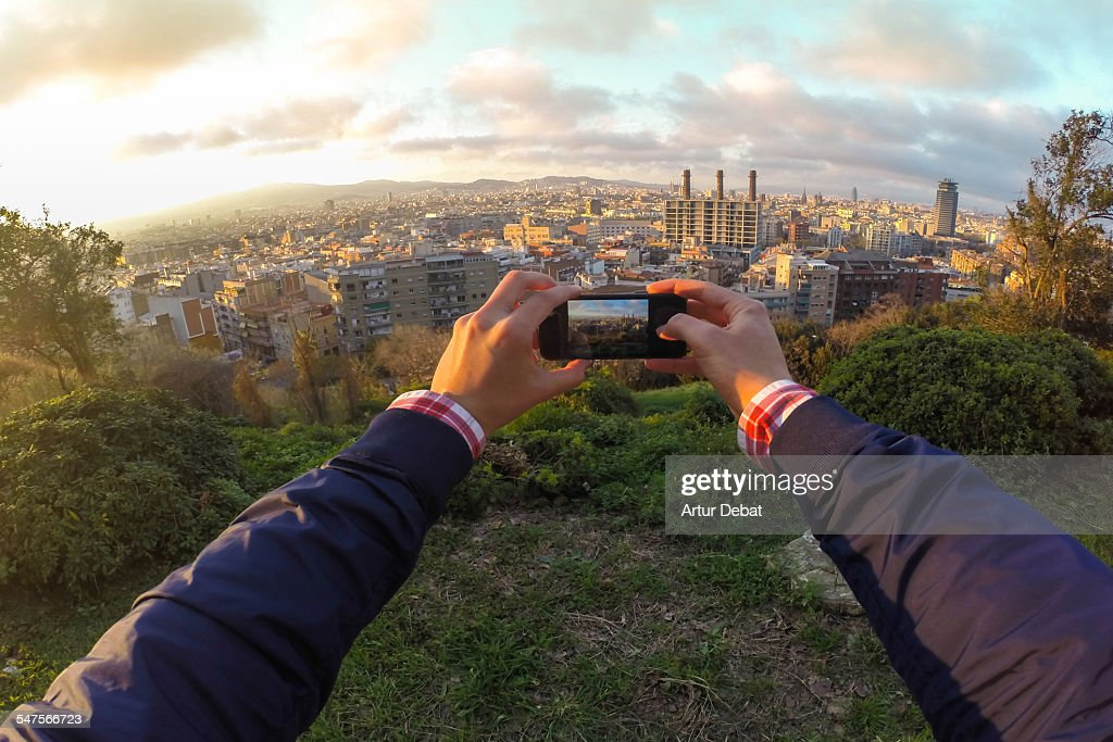 Guy taking pictures with phone on Barcelona city. : Stock Photo