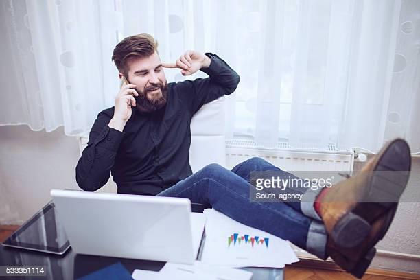 Guy talks on mobile in office