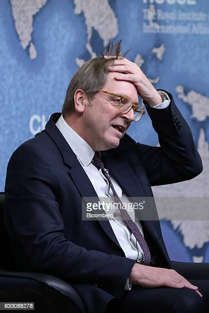 Guy Verhofstadt Brexit negotiator for the European Parliament adjusts his hair before delivering a speech at Chatham House in London UK on Monday Jan...