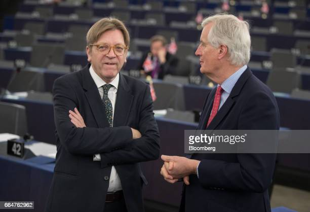 Guy Verhofstadt Brexit negotiator for the European Parliament left speaks with Michel Barnier the European Union's chief Brexit negotiator as they...