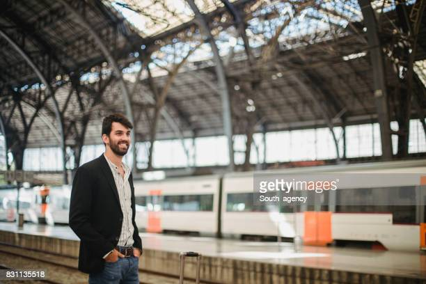 Guy waiting for a train