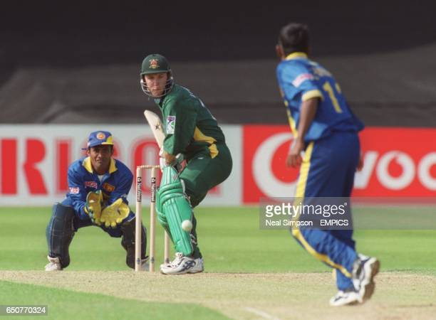 Guy Welton of Nottinghamshire keeps his eyes on the ball watched by Sri Lanka wicketkeeper Hashan Tillakaratne