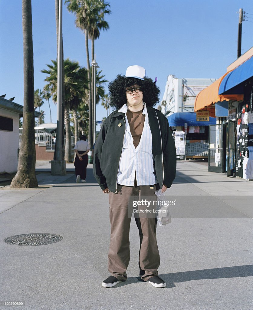 Guy with big hair on the boardwalk. : Stock Photo