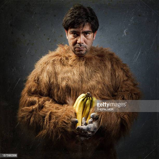 guy with gorilla custome and bananas