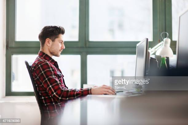 IT Guy Working At Desk