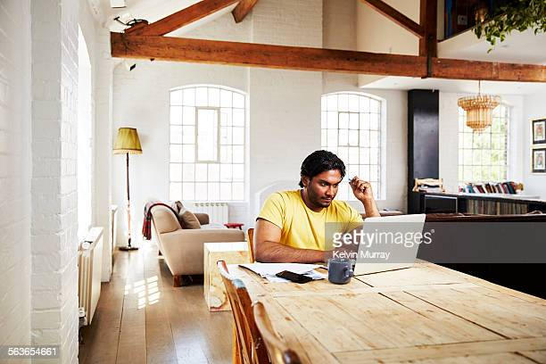 A guy working from home on a sunny day