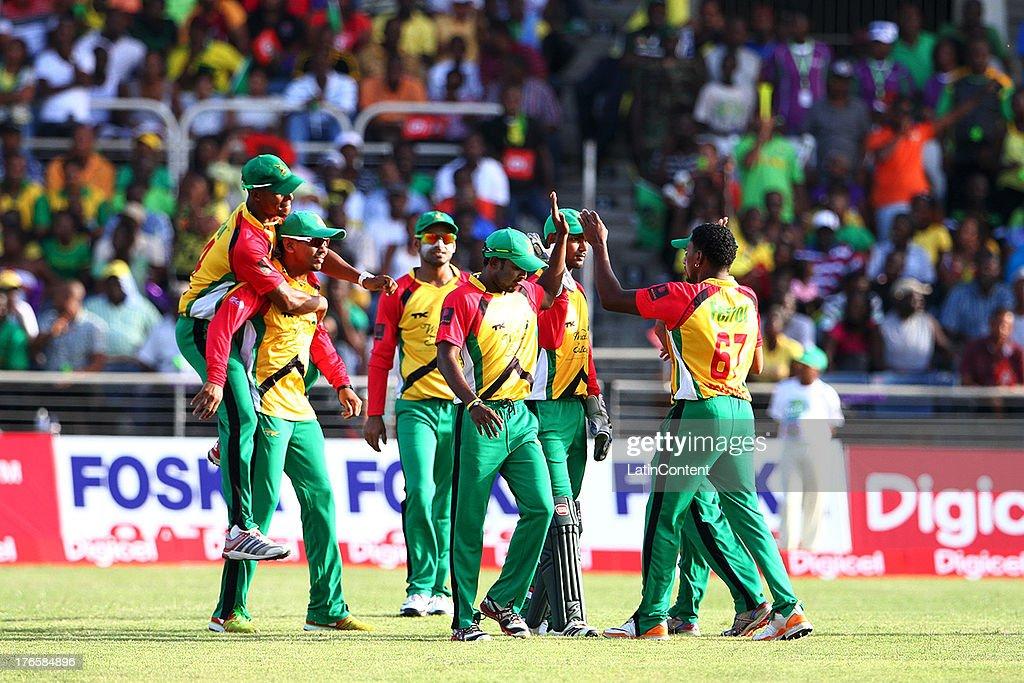 Guyana celebrate during the Sixteenth Match of the Cricket Caribbean Premier League between Jamaica Tallawahs v Guyana Amazon Warriors at Sabina Park on August 15, 2013 in Kingston, Jamaica.