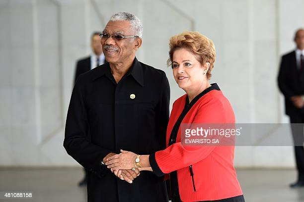 Guyana's President David Granger and Brazil's President Dilma Rousseff shake hands during the welcome ceremony of the the MERCOSUR Summit of Heads of...