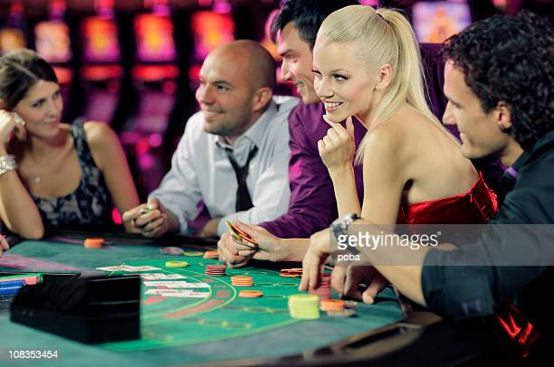 guys and girls playing black jack in casino