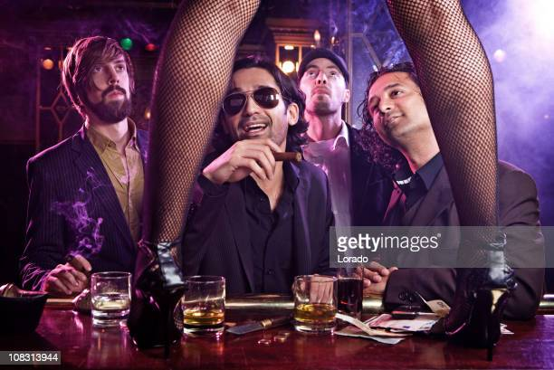 guys looking at girl dancing striptease