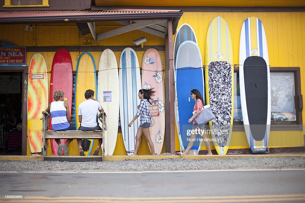 Guys watching girls walking down a sidewalk : Stock Photo