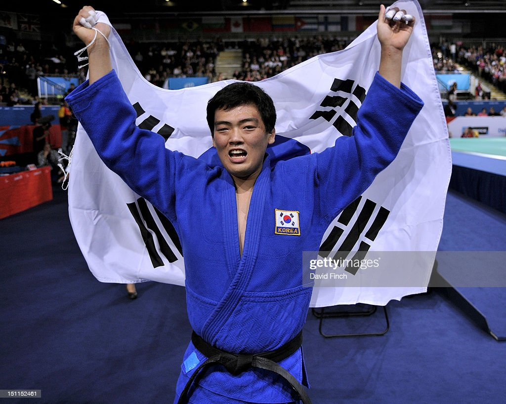 Gwang-Geun Choi of Republic of Korea proudly holds the South Korean flag after winning the u100kgs final on Day 3 of the London 2012 Paralympic Games at the ExCeL on April 30, 2012 in London, England.