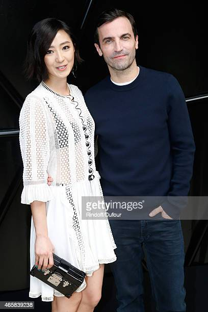 Gwei Lun Mei and Fashion Designer Nicolas Ghesquiere pose after the Louis Vuitton show as part of the Paris Fashion Week Womenswear Fall/Winter...