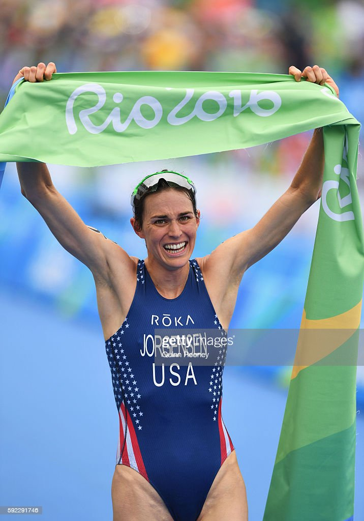 Gwen Jorgensen of the United States celebrates as she wins gold during the Women's Triathlon on Day 15 of the Rio 2016 Olympic Games at Fort Copacabana on August 20, 2016 in Rio de Janeiro, Brazil.